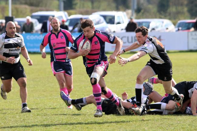 Stour centre Joe Heatley leaves Lucs defenders in his wake on his way to Stour's fourth try. Photo by Ceri Davies