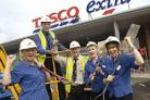 Tesco Extra Store Manager George King receives the keys to his store from Robin Rothwell, Retail Support Manager, watched by (left to right) Checkout operators Kath Ashworth, Elaine Morgan and Sarah Purnell.