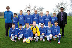 Pictured: The school football team with coach Chris Brady and Shahidur Rahman.