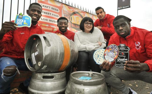 Kelly Perks-Bevington with Harriers players Mani Dieseruvwe, Richard Sho-Silva, Robert Stamboiziev and Ken Digie ready for the club's Oktoberfest event this weekend