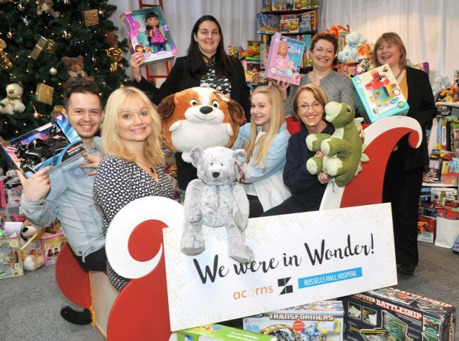 Christmas joy: Jo Gregory, Dan Murphy and Lauren Miles from Zion, Claire Cooper, Jayne Holliday and Jenny Smith from Thursfields, and Tanya Fellows from Acorns