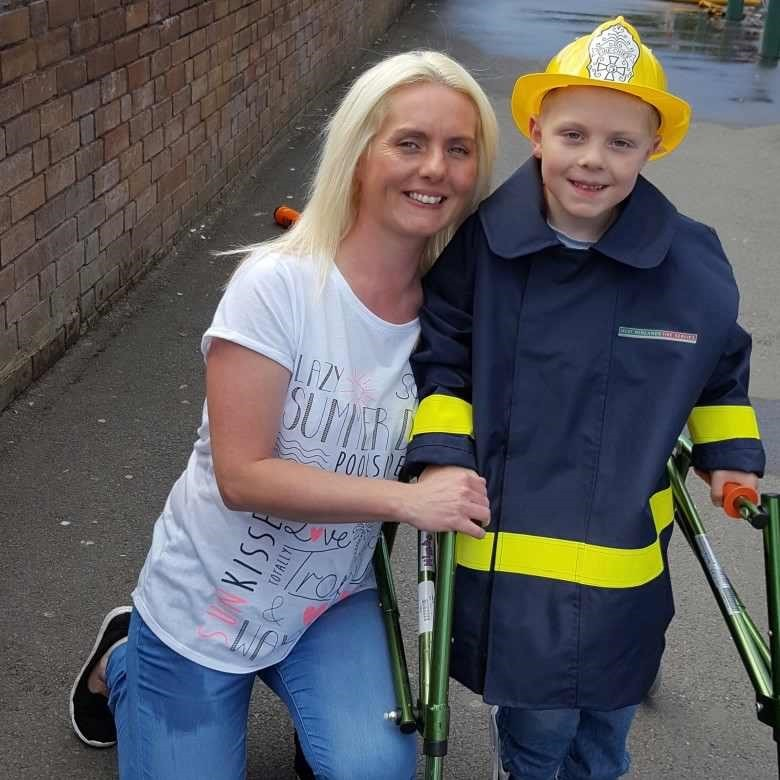 James Downing with his mum Cheryl Hughes