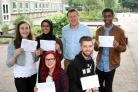Ormiston Forge Academy students Maisy Neale, Halima Sultana, Lauren Bradley, Richard Walker and K-Ryan Hinds celebrate their A-level results with principal Andrew Burns.