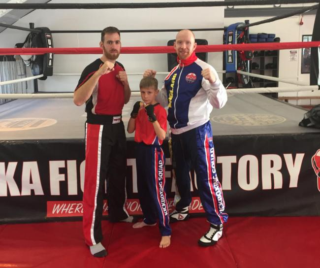 Rowley Regis kickboxers Arron Walker and Harvey Adlam with England National Ringsports coach Neil Kelly. Photo: Sandwell Council