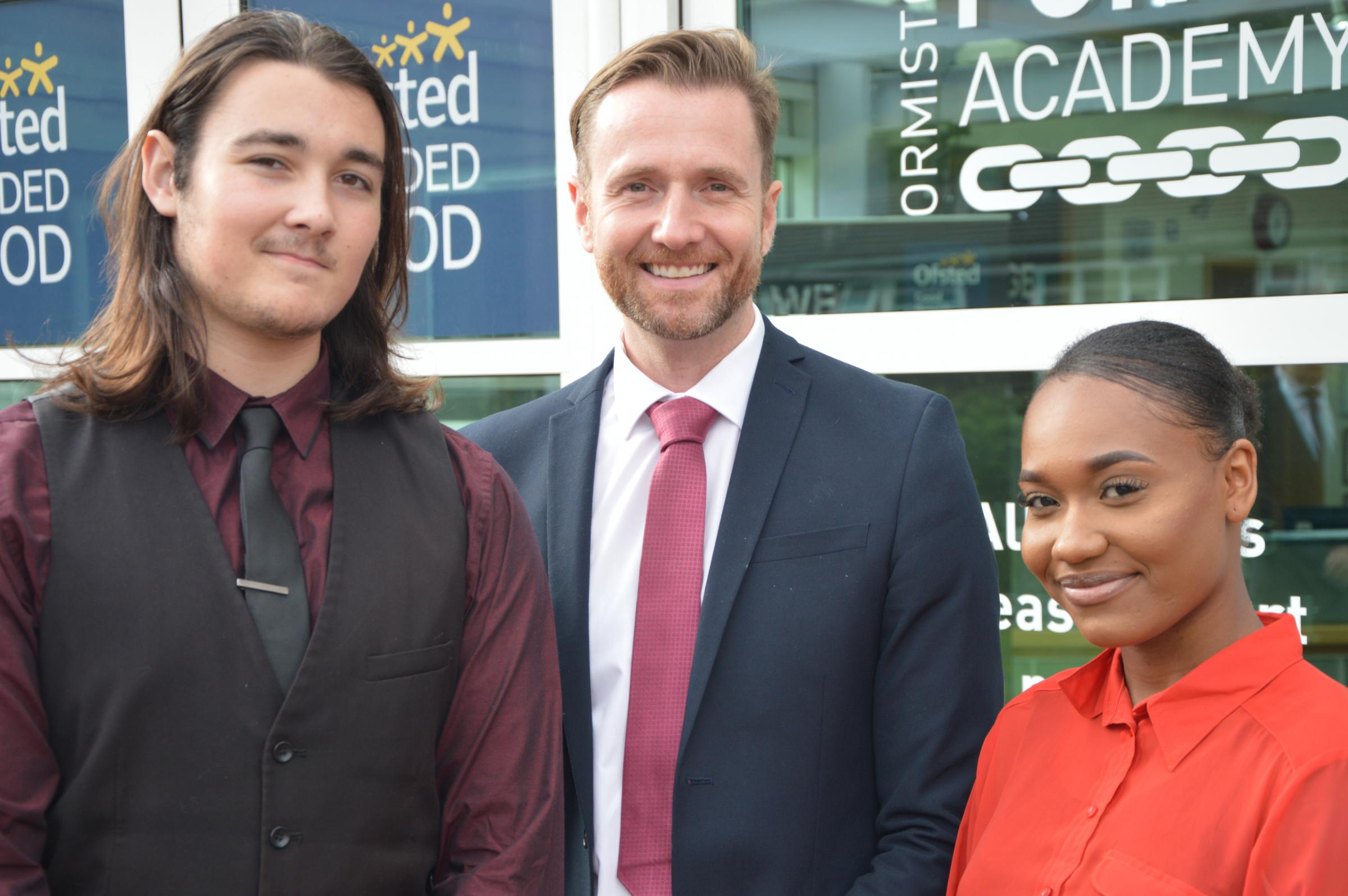 Ormiston Forge Academy's Cameron Allen and Divine Matondo with assistant principal Darren Grimes.