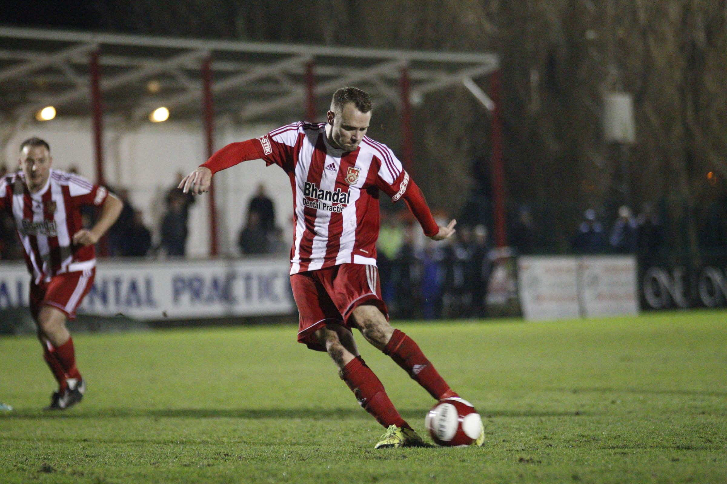 Leon Broadhurst sweeps home from the penalty spot. Photo by Andrew Roper