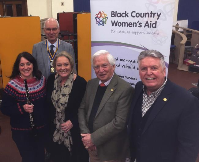 Halesowen Orchestra's Julie Billingham and Deborah Slater, of Black Country Women's Aid, joined by Halesowen Rotarians John Cartwright, Barry Wheeler and Alan Bowler.