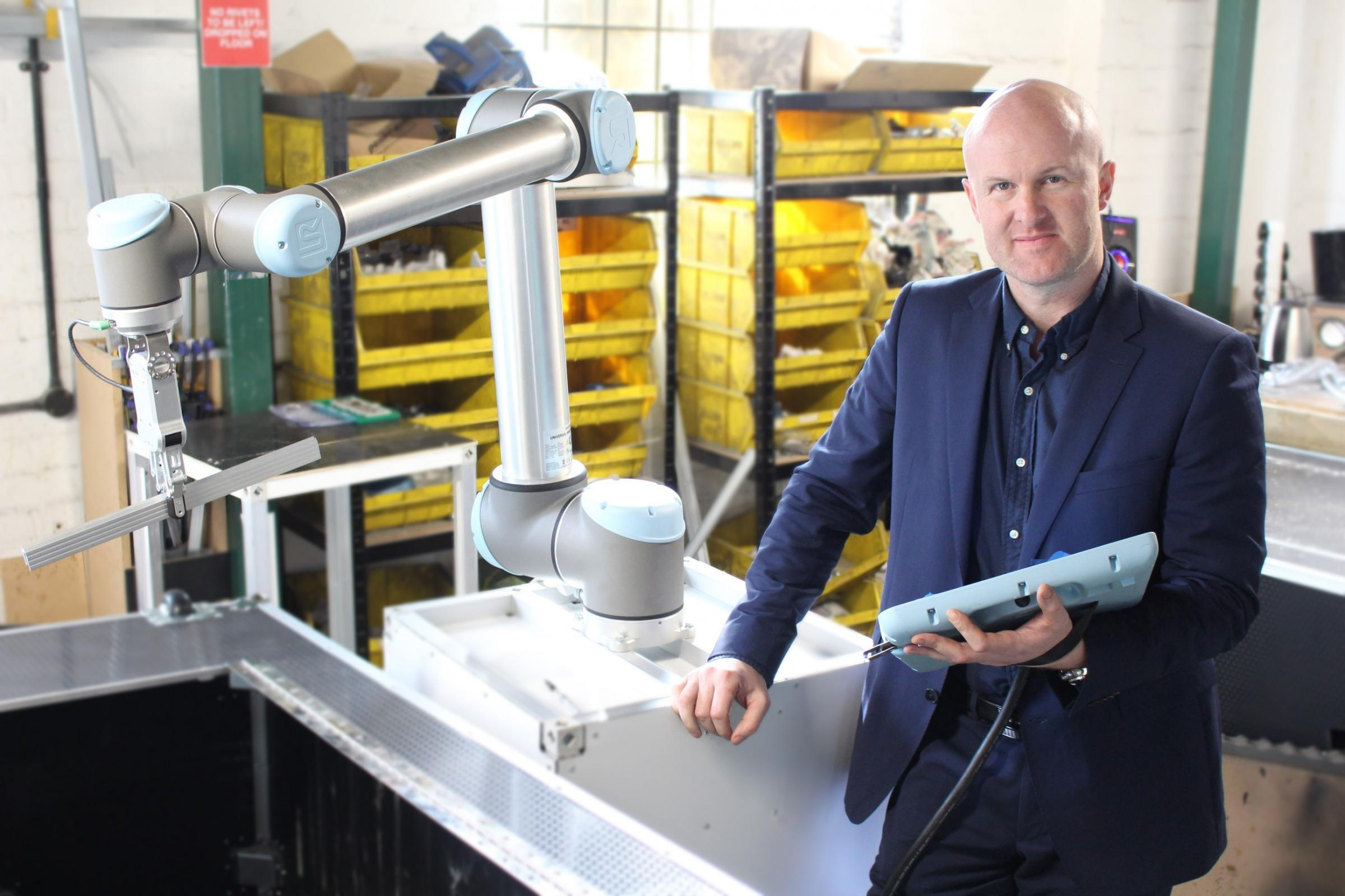 Tim Warrington, CEO and founder of Bots.co.uk, with the innovative 'Cobots'.