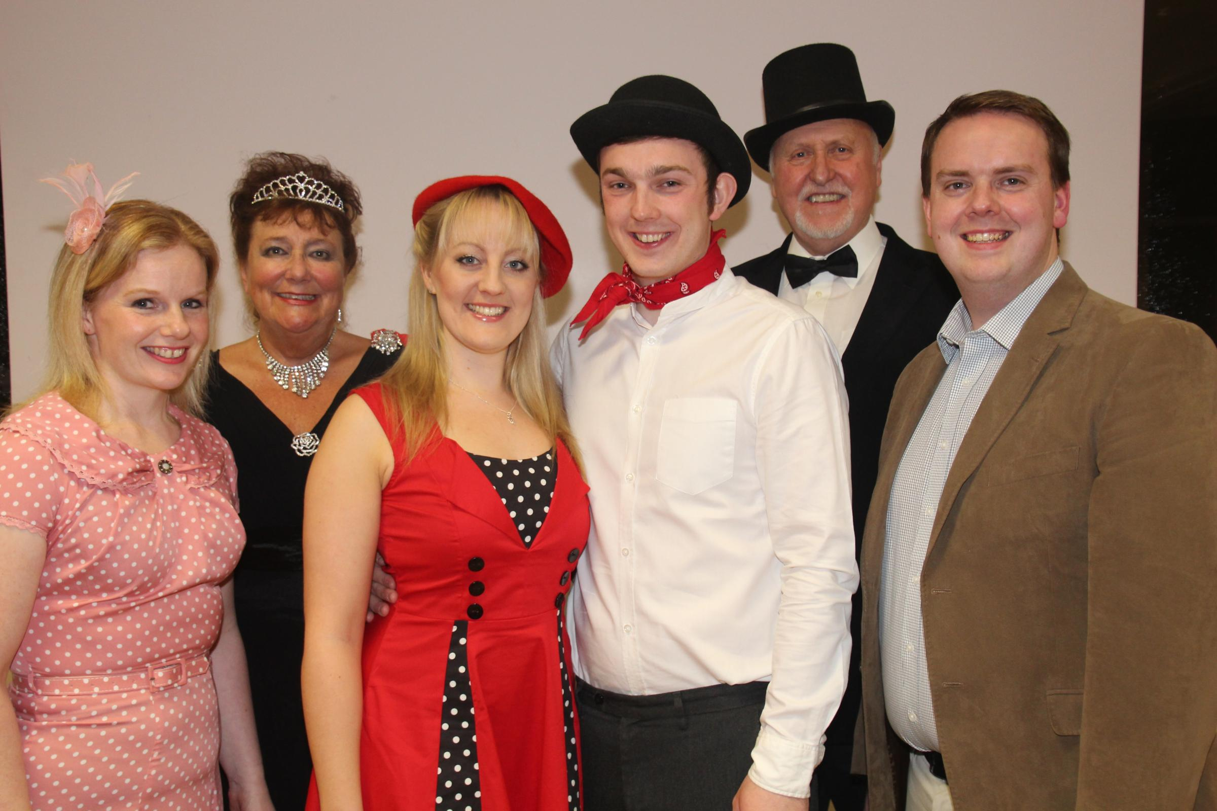 L-r - Gabby Thompson as Lady Jacqueline, with Richard Cooper and Rebecca Bate (centre) as Bill Snibson and Sally Smith, and Simon Wilkinson as Gerald. Back l-r - Di Hingley as the Duchess of Dene and John Clay as Sir John Tremayne.