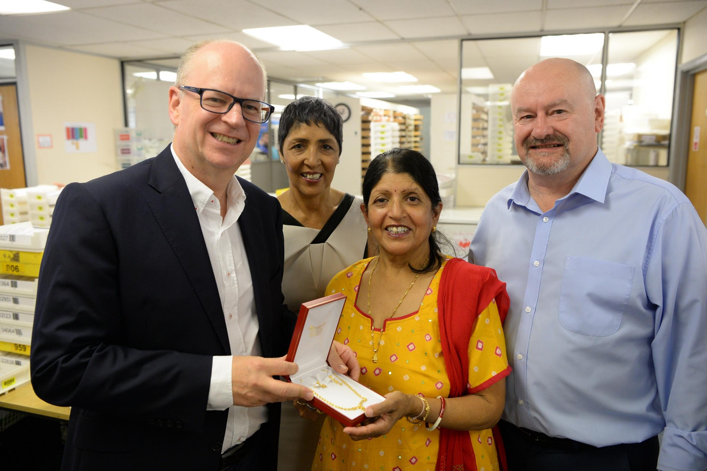 Jashumati Lad receiving her retirement gift from Scrivens director Mark Georgevic, alongside Jeet Saimbi, professional services and training director at Scrivens, and Gary Davies, general manager at Mersona.