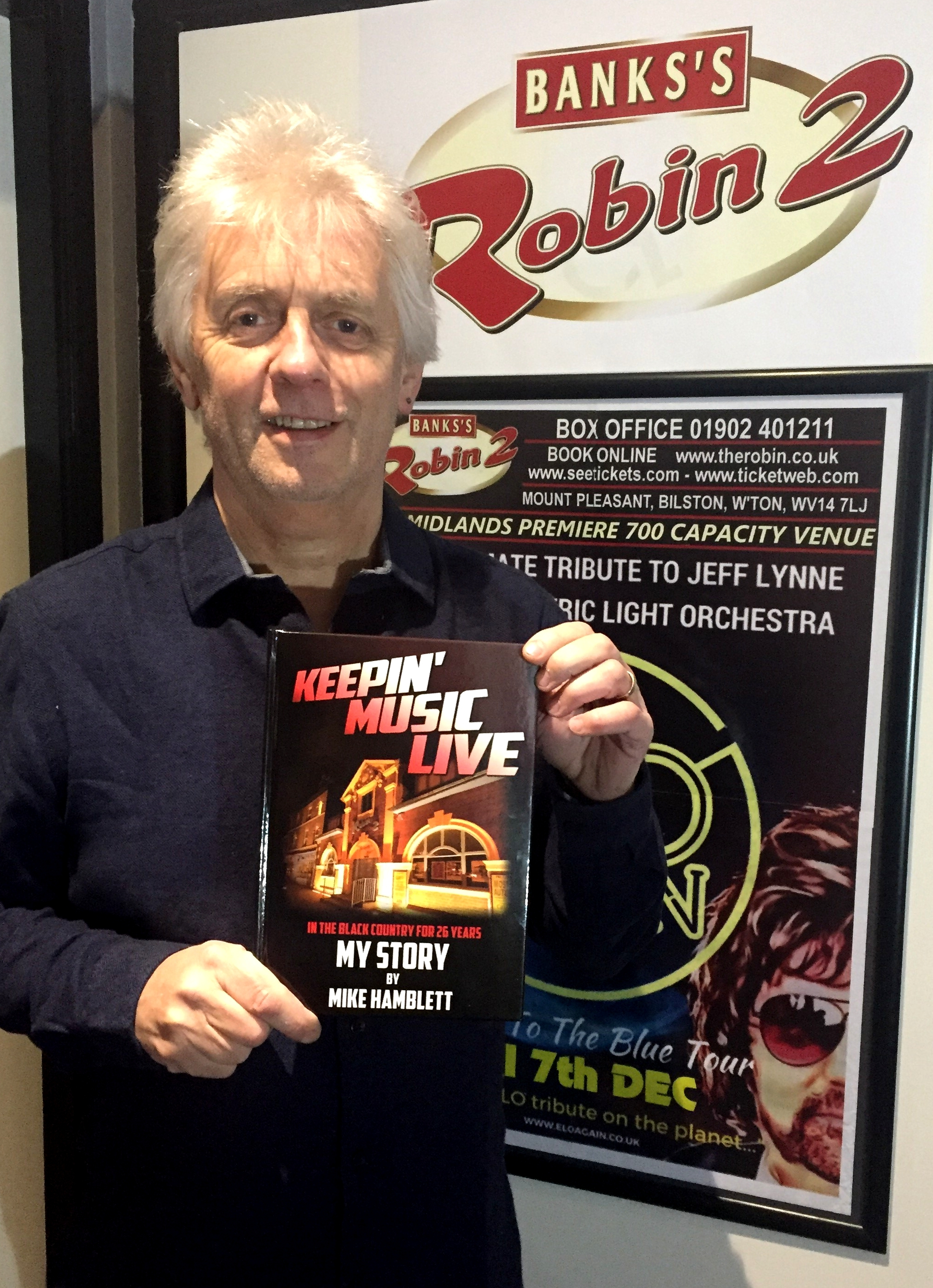 Mike Hamblett with his Keepin' Music Live book