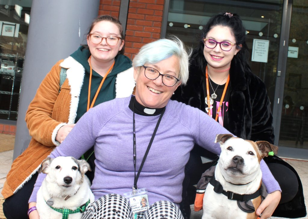 Rev. Hazel Charlton with her dogs Pippa and Sophie and students Phoebe Jackson (left) and Sophie Edwards