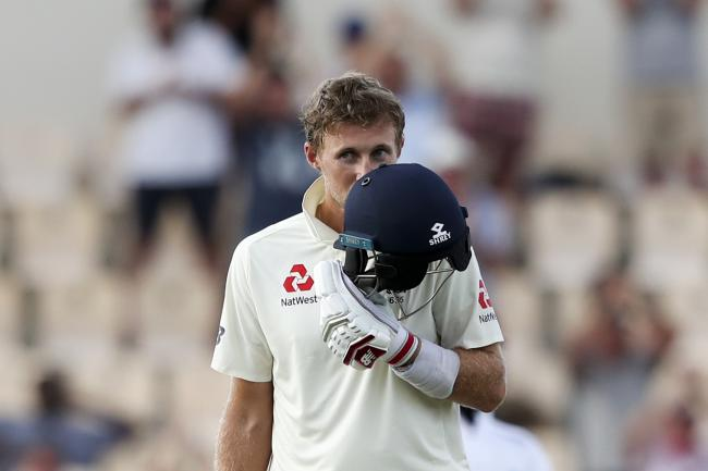 Joe Root celebrates his century