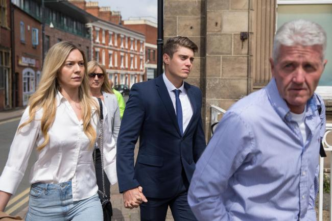 "Alex Hepburn, (centre) arrives for sentencing at Hereford Crown Court, with partner Lucy Street (left), for raping a woman he found ""dozing"" in his team-mate's bedroom. Picture: Aaron Chown/ PA Wire"