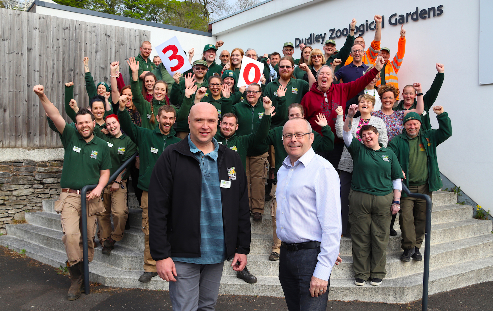 Matt (pictured left front) is congratulated by Zoo Director Derek Grove (right) and the team from Dudley Zoo.