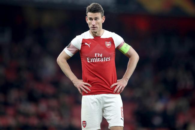 Laurent Koscielny has refused to travel on Arsenal's pre-season tour.