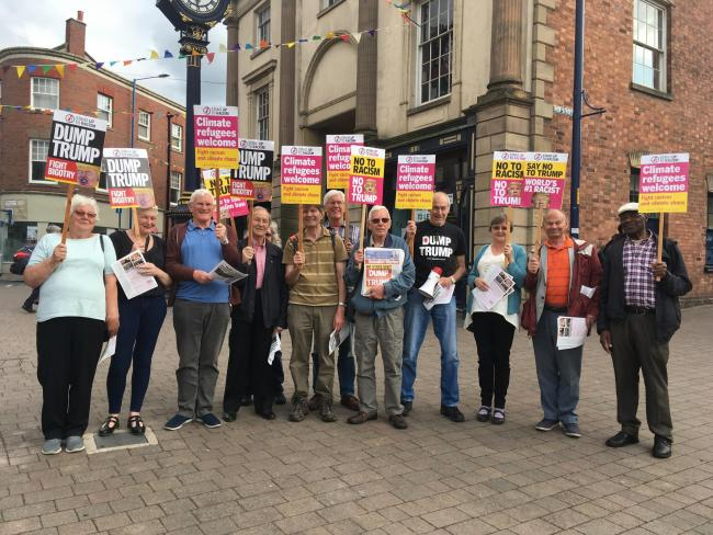 Members of Black Country Stand Up To Racism group gather in Stourbridge to protest over US President Donald Trump's visit to Britain
